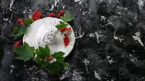 Meringue desert with red berries on plate on dark background. Top view. Free copy space stock images