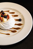 Meringue dessert with fruit and sauce Royalty Free Stock Photos