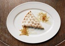 Meringue dessert on wooden table Stock Photo