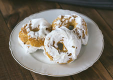 Meringue donuts on a white plate Royalty Free Stock Images