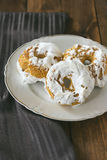 Meringue donuts on a white plate Royalty Free Stock Photo