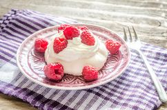 Meringue with fresh raspberries Royalty Free Stock Images
