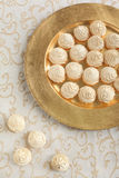 Meringue on golden plate Royalty Free Stock Photo