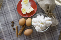 Meringue ingredients with cinnamon and anis stars Stock Photography