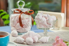 The meringue kisses in the glass vase and jars Royalty Free Stock Image