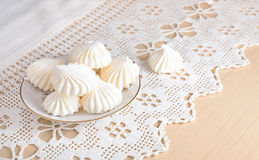 Meringue on a lacy cloth. Stock Images
