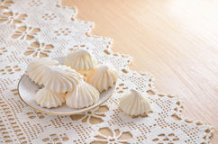 Meringue on a lacy cloth. Stock Photo