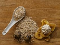 Meringue and oatmeal and eggs and banana chips wood texture stock image