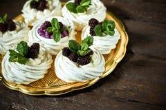 Meringue pavlova dessert Food industry, mass or volume production. pastry chef making dessert. Meringue pavlova dessert Food industry, mass or volume production stock images