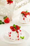 Meringue 'Pavlova' with strawberries Stock Image