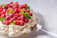 Meringue Pavlova  with whipped cream and fresh raspberries. Meringue Pavlova  with whipped cream and fresh raspberries, selective focus Royalty Free Stock Photo