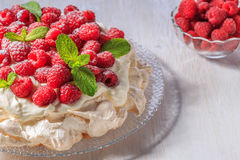 Meringue Pavlova  with whipped cream and fresh raspberries. Meringue Pavlova  with whipped cream and fresh raspberries, selective focus Stock Photos
