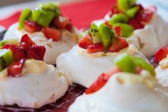 Meringue Pavlovas with strawberry and kiwi fruit topping Stock Images
