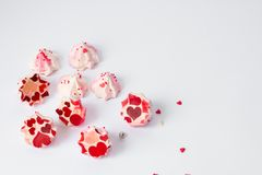 Meringue pink with red flowers, love hearts and an inscription stock photography