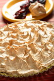Meringue with plums. Delicious meringue with plums and plum brandy Stock Image