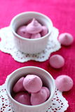 Meringue. Raspberry meringue made from whipped egg white and sugar Stock Image