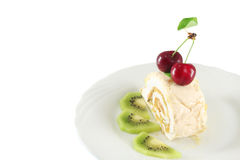 Meringue roll with cherries and kiwi Stock Images