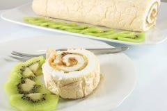 Meringue roll with kiwi Stock Image