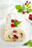 Meringue roulade. With cream and raspberries Royalty Free Stock Photography