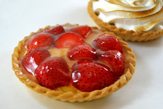 Meringue  and strawberries tarts Royalty Free Stock Images