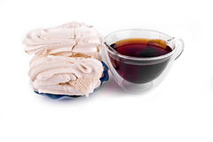 Meringue with tea Stock Photography