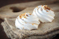 Meringue with toasted almonds Stock Images