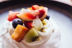 Meringue topping with fresh fruits including strawberry, mango, kiwi, blueberry and common fig served with sour fruit sauce Royalty Free Stock Image