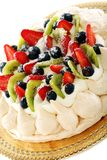 Meringue with whipped cream and berries. Stock Photo