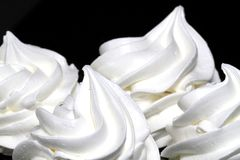 Meringues. Some white meringues on black background Royalty Free Stock Image