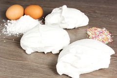 Meringues. On the table with eggs Royalty Free Stock Photography