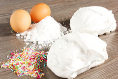 Meringues. On the table with eggs Royalty Free Stock Photos