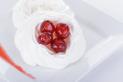 Meringues and Cherries Stock Photo