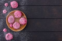 Meringues cookies on wooden plate Royalty Free Stock Photography
