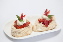 Meringues filled with strawberries and cream Royalty Free Stock Image