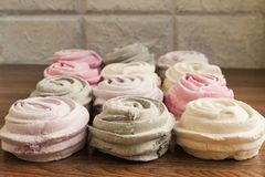 Meringues with flowers,dessert zephyr rose sweet. Meringues with flowers dessert zephyr rose sweet cake food delicious gourmet colorful white pink red lilac gray royalty free stock photo