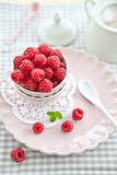 Meringues with fresh raspberries. On a pink plate Royalty Free Stock Photo