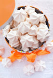 Meringues in orange box with bow Royalty Free Stock Images