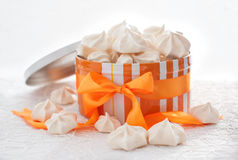 Meringues in orange box with bow Royalty Free Stock Photos