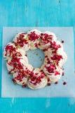 Meringues pavlova cake wreath with pomegranate, cranberry and pi Royalty Free Stock Photography