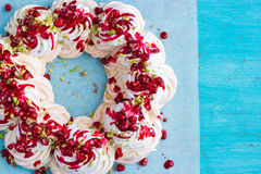 Meringues pavlova cake wreath with pomegranate, cranberry and pi Stock Images