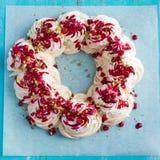 Meringues pavlova cake wreath with pomegranate, cranberry and pi Stock Image