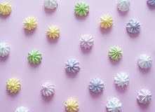 Meringues on pink background Royalty Free Stock Images