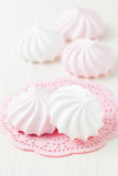 Meringues on pink mat Stock Photos
