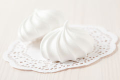 Meringues on white mat Stock Images