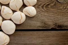 Meringues on wooden table Stock Photo