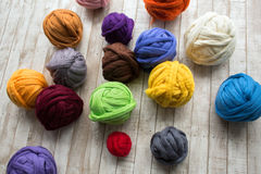 Merino wool balls in multicolor lying Royalty Free Stock Photos