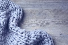 Merino wool blanket. On a grey wooden background stock photo