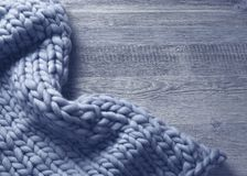 Merino wool blanket. On a grey wooden background royalty free stock photos