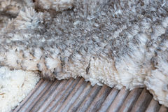 Merino wool on wooden sorting table Stock Images