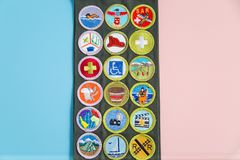 Merit Badge Sash on Blue and Pink. SAINT LOUIS, UNITED STATES - MAY 3, 2018:  Boy Scouts of America BSA merit badge sash on pink and blue background as BSA Stock Photography
